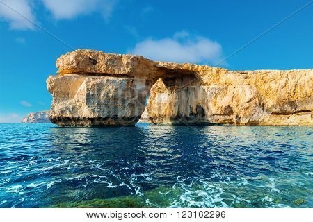 Azure Window, famous stone arch of Gozo island in the sun in the winter Malta