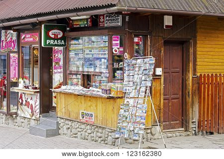 ZAKOPANE POLAND - MARCH 09 2016: Newsstand offers latest newspapers and magazines. Thanks to good location at Krupowki street in downtown provides daily access also to many various small products