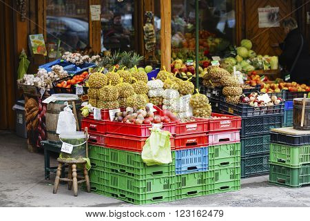 ZAKOPANE POLAND - MARCH 07 2016: Nuts beans and other vegetables and fruits offered for sale at a street market stall placed in front of the store site at the local market