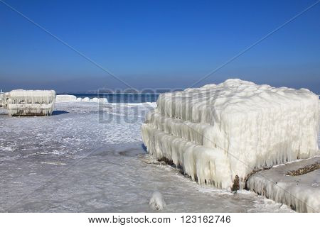 The picture was taken in Ukraine in the area of the port of Odessa. The picture shows a frozen after a strong storm sea water. It seems that this is a fantastic ice architecture. This area is quite rare.