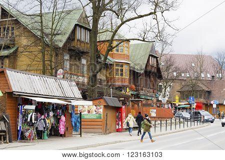 ZAKOPANE POLAND - MARCH 07 2016: Wooden building until 1898 the biggest hotel in Zakopane. Nowadays it houses famous Gazdowo-Kuznia restaurant and milk-bar