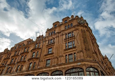 LONDON, UK - FEBRUARY 08, 2016: View of famous department store Harrods (80,000 sq m) in London. First Harrods was opened at 1849 and now it is one of the most famous luxury store in London.