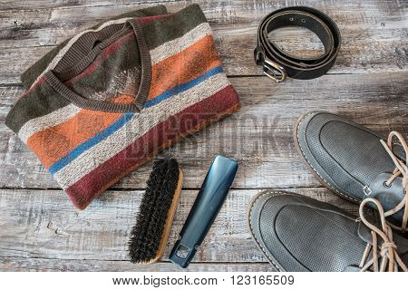 Travel vacation concept of random men's objects on wooden background