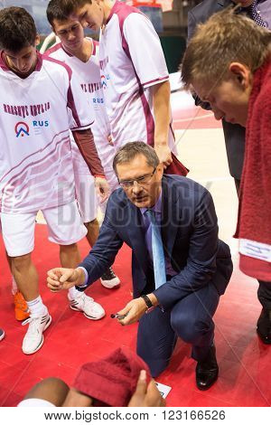 SAMARA RUSSIA - NOVEMBER 06, 2013: Timeout. Head coach of BC Krasnye Krylia Sergey Bazarevich during a timeout of the BC Royal Hali Gaziantep basketball game on November 06 2013 in Samara Russia.