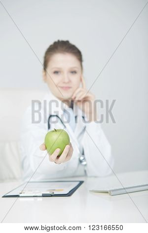 young beautiful dietician holding fruits for safe
