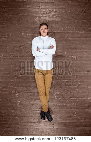 Top view creative photo of handsome young man on vintage brown wooden floor