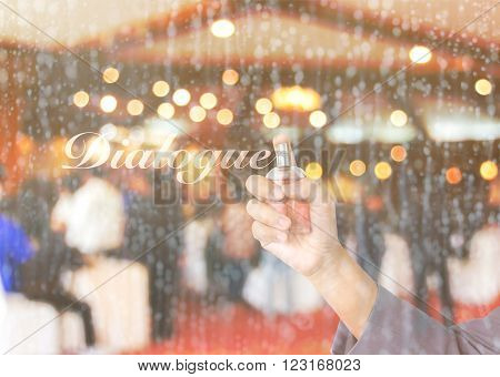 Business women hand holding perfume bottle spraying text dialogue on waterdrop glass window with blurred people meeting in convention room background