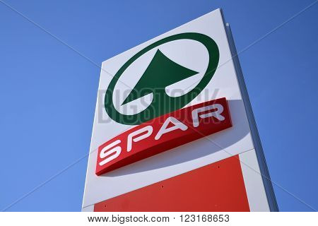 MATREI IN OSTTIROL, AUSTRIA - MARCH 28: Dutch multinational retail chain and franchise Spar logo with blue sky in background on March 28, 2012 in Matrei in Osttirol, Austria. The organization comprises over 12 000 stores in 40 countries.
