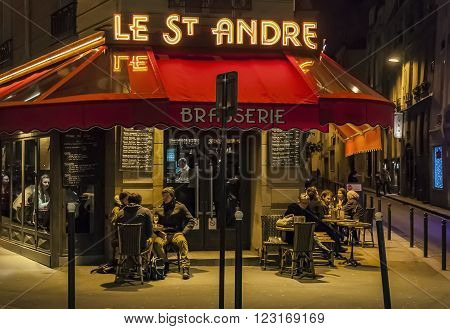 PARIS - MARCH 1: typical Paris cafe with people that enjoy dinner on March 1 2014 in Paris France