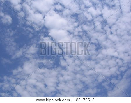 White Cirrus clouds against a blue sky on a clear summer day