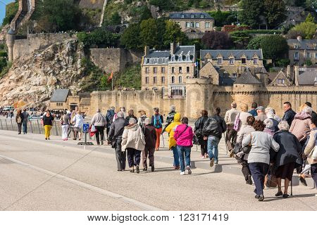 FRANCE MONT SAINT MICHEL - SEPTEMBER 26: Old people visiting Mont Saint Michel monastery Brittany France on September 26 2015