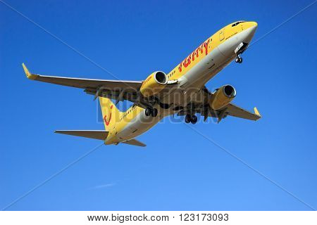 PALMA DE MALLORCA SPAIN - AUGUST 07 2013: Tuifly Boeing 737-800 airplane approaching to land at Palma of Majorca airport