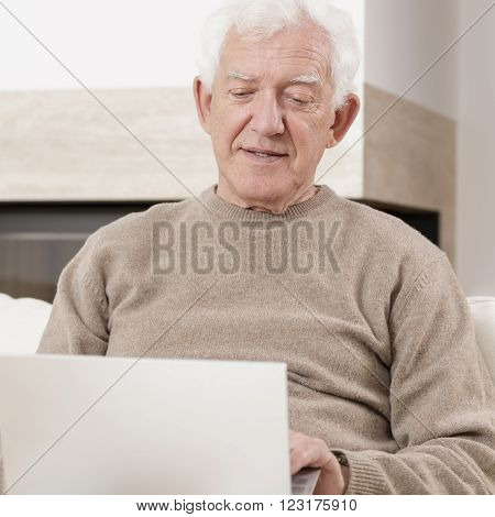 Old man and his new and modern laptop