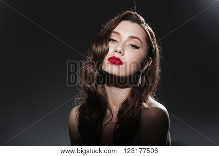 Beauty portrait of a young charming woman with fresh skin on black background