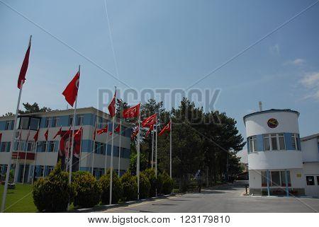 ANKARA/TURKEY-MAY 6, 2012: Turkish Air Association-THK Turkkusu infirmary building (R) at the Etimesgut Airport,during the air fest. May 6, 2012-Ankara/Turkey
