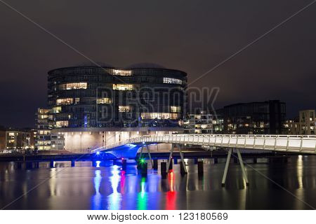 Copenhagen, Denmark - March 22, 2016: Modern cyclist and pedestrian bridge Bryggybroen and Gemini residence by night