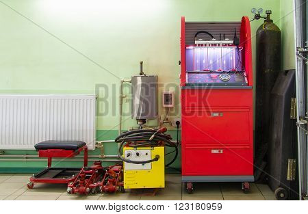 Injector repairing machine in workshop car service station against the wall