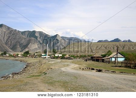 Siberia, Russia - June 10, 2012: Mountain River Katun And A Village In Altai Mountains, Russia