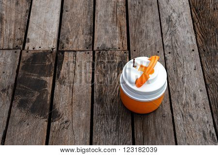 Orange-white ice picnicking on wood deck on vacation