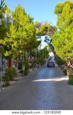 GREECE CRETE AGIOS NIKOLAOS - JULY 12/2014: Tourists walk through the picturesque streets of Agios Nicolas