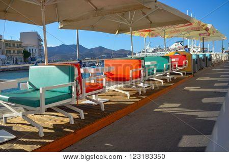 GREECE CRETE AGIOS NIKOLAOS - APRIL 10/2014: the beginning of the tourist season. Owners of restaurants prepare the interiors of their establishments in the open air.