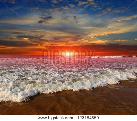 Nice scene with majestic sunset over ocean shore