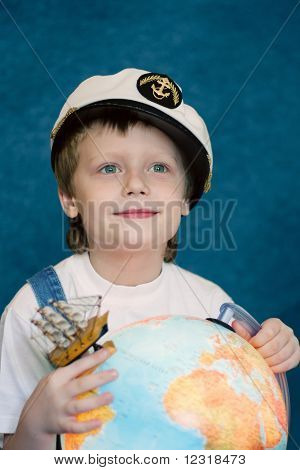 cute dreaming child with the globe model
