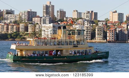 Sydney - February 25 2016: Beautiful green-yellow passenger Sydney ferry carries passengers to the port of Sydney February 25 2016 Sydney Australia
