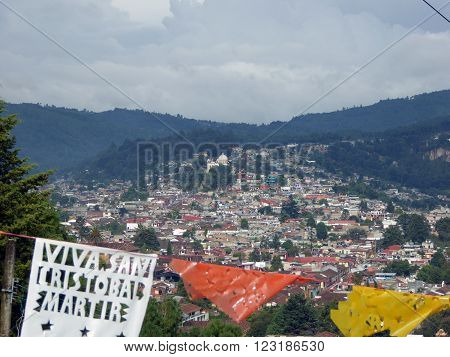 An overview of the Mexican colonial city of San Cristobal de las Casas as seen from a hill.