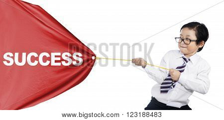 A little businessman pulling a banner of success
