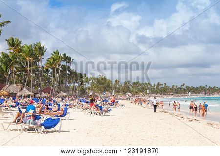 Tourists Rest On A Sandy Beach Of Punta Cana Resort