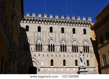The facade of the Palazzo Salimbeni XIV century - one of the most beautiful palaces in Italy. Sienna. Italy.