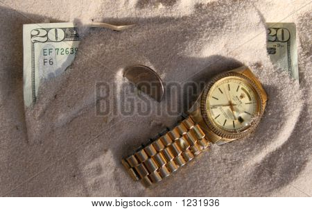Us Money And Expensive Watch Buried In Sand