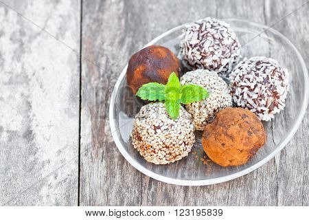 Assorted dark chocolate truffles with cocoa powder and sesame seeds