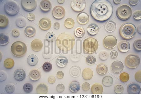 Vintage Look Photo Of Many Sewing Buttons On White Background
