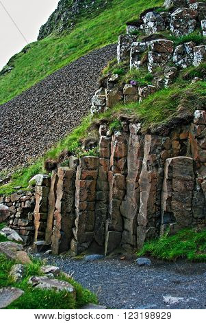 Giants Gate walking path through Giants Causeway in Northern Ireland along the Irish coastline