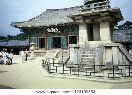 GYEONGJU CITY, NORTH GYEONGSANG PROVINCE / KOREA - CIRCA 1987: Visitors visit the historic Bulguksa Buddhist temple, a UNESCO Heritage Site.