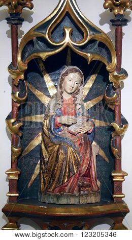 BENEDIKTBEUERN, GERMANY - OCTOBER 19: Virgin Mary altarpiece in Saint Benedict basilica in the famous Benediktbeuern abbey, Germany on October 19, 2014.