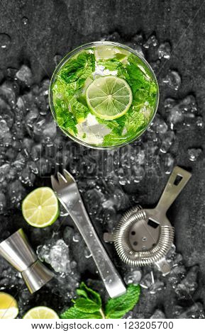 Glass of cold drink with lime mint ice. Tonik water cocktail mojito caipirinha. Top view