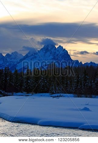 Snake River at sunset below Grand Teton Mountain Range