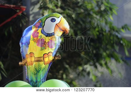 Photograph of an helium colorful parrot balloon