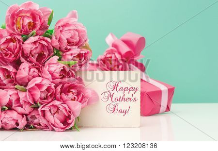 Pink tulips gift box and greetings card with sample text Happy Mother's Day!