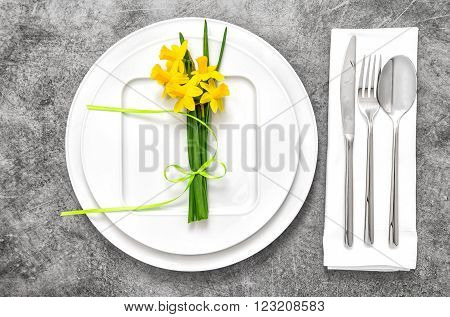 Festive able place setting with spring flowers decoration