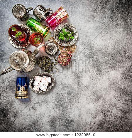 Tea table. Oriental hospitality. Eid Mubarak. Vintage style dark toned picture