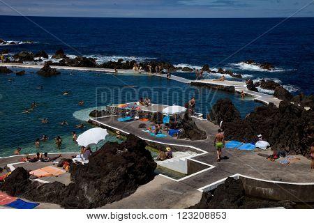 PORTO MONIZ, MADEIRA, PORTUGAL - AUGUST 25: Natural pools of Porto Moniz, on March 13, 2016 in Porto Moniz, Madeira Island, Portugal
