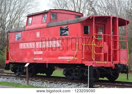 RICHLAND, NEW JERSEY  MARCH 21, 2016  A retired steel train caboose on display in a public park.