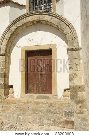 The Romanesque lateral doorway of the Church of Saint Mary with a perfect double arch and original imposts in Torres Vedras Portugal