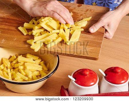 Sliced Potatoes On A Wooden Table.