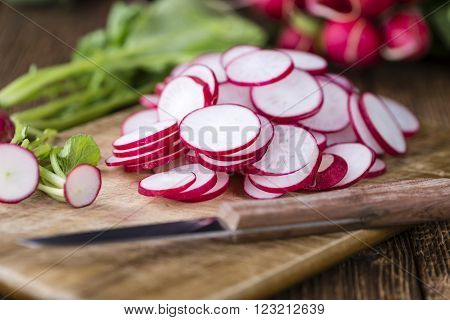 radish; radishes; portion; slice; sliced; chopped; cutted; raw; red; food; root; healthy; vegetarian; vegetable; fresh; ripe; ingredient; plant; harvest; natural; group; organic; nature; nutrition; bunch; agriculture; salad; freshness; closeup; bundle; di