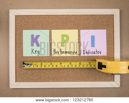 KPI (Key Performance Indicator) on cork board background (Business concept)